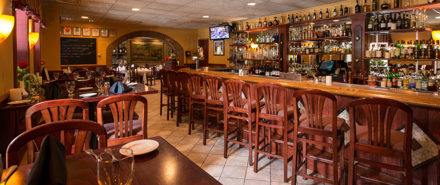 the bar that features barstool seating, high tables and screens for your favorite sporting event